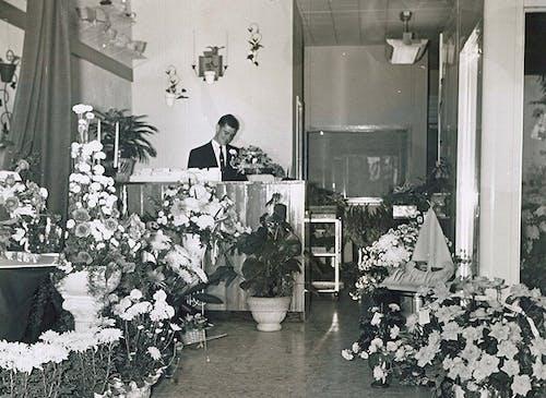 A member of the McNamara staff, waiting to help at the customer service desk, circa 1950